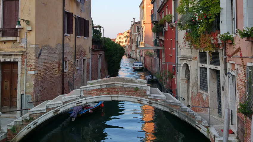 The bridge in Venice where my main character would later sit in silence and ask, 'Do you ever think that the music we listen to is the soundtrack to our lives?'