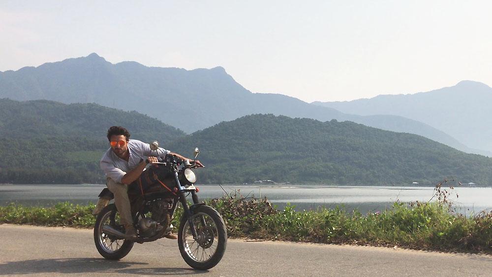 Author writer Joshua Humphreys on Briseis, his Suzuki GN125, in Vietnam.